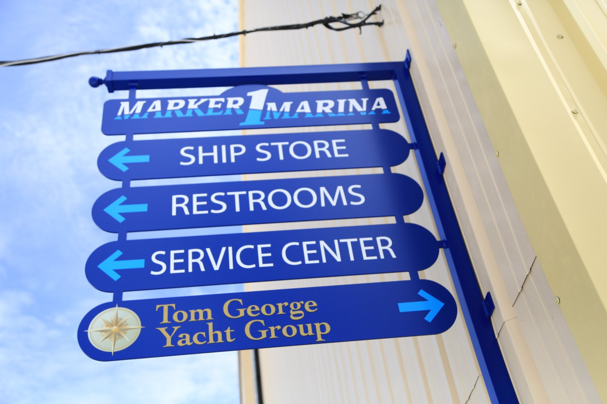 Tom George Marina signage